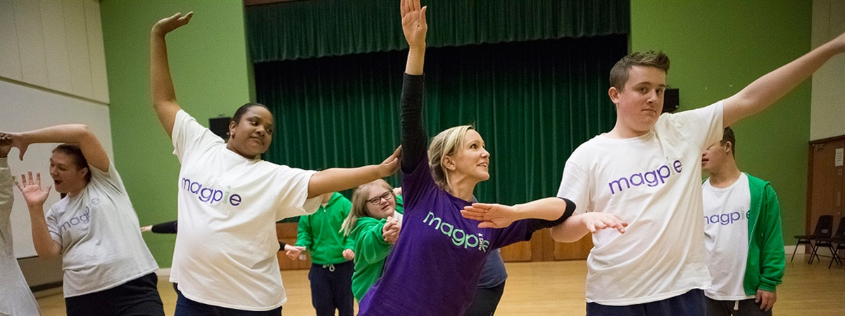 Photo shows Natasha Britton leading a Magpie Dance class